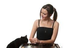 Woman play backgammon Stock Photo