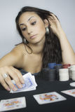 Woman play cards Stock Images