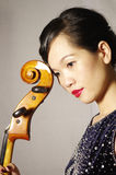 Woman play cello. Portrait of woman and cello Stock Image