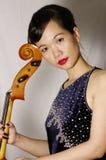Woman play cello. Portrait of woman and cello Stock Photos