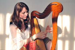 Woman play celtic harp Stock Photos