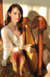 Woman play celtic harp Royalty Free Stock Photography