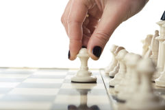 Woman play chess game Stock Photography