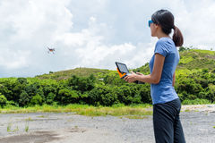 Woman play with drone Stock Photography