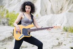 Woman play famous song on bass guitar Stock Image