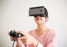Woman play game with virtual reality device Stock Images