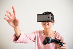 Woman play game with virtual reality device and hand want Stock Image