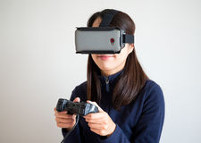 Woman play game on vr device Royalty Free Stock Images
