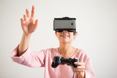 Woman play game with vr device and hand want to touch some Royalty Free Stock Photo
