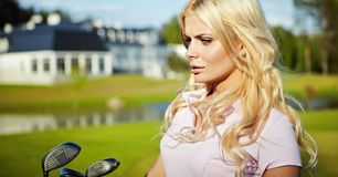Woman play golf Stock Photography