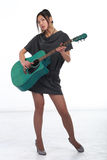 Woman play guitar Royalty Free Stock Image