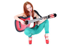 Woman play with guitar Royalty Free Stock Image
