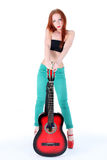 Woman play with guitar Royalty Free Stock Images