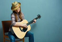Woman play guitar - Country style Stock Photography