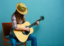 Woman play guitar. Country style Royalty Free Stock Photo