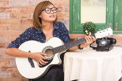 Woman play guitar Stock Photography