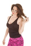 Woman play hair glasses pink skirt Stock Photo