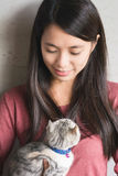 Woman play with her kitten. An Asian woman play with her kitten at home Stock Photography