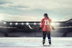 Woman play hockey  . Mixed media Royalty Free Stock Images