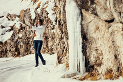 Woman play with ice and snow in mountains Royalty Free Stock Image