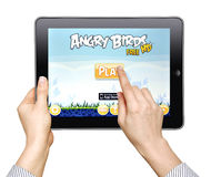 Woman Play In The Game Angry Birds Stock Image