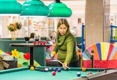 Woman play pool royalty free stock photo