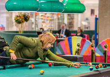 Woman play pool Stock Images
