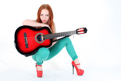 Woman play with red guitar Royalty Free Stock Photo