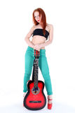 Woman play with red guitar Royalty Free Stock Photography