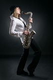 Woman play on saxophone Royalty Free Stock Photography