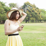 Woman play smart phone. Royalty Free Stock Images