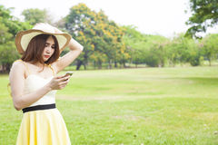 Woman play smart phone. Stock Images