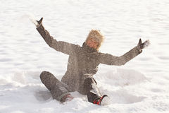 Woman play in the snow Stock Photography