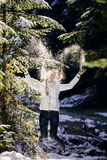 Woman play with snow in forest Stock Photo