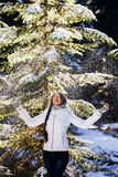 Woman play with snow in forest Stock Images