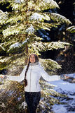 Woman play with snow in forest Royalty Free Stock Photo