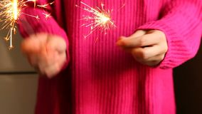 Woman play with sparkler or Bengal lights in hands. Holidays concept stock video footage