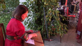 Woman play string instrument in John feast celebration concert stock footage
