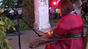 Woman play with string instrument in John feast concert stock video