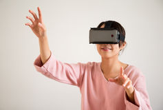 Woman play tv game on virtual reality glasses Royalty Free Stock Image