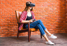 Woman play video game with joystick and VR device Royalty Free Stock Photos