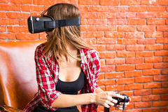 Woman play video game with joystick and VR device Stock Image