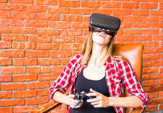 Woman play video game with joystick and VR device Stock Photography