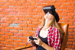 Woman play video game with joystick and VR device Stock Images