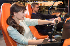 Woman play video game at recreational salon stock photo