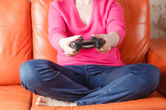 Woman play video games Stock Photography