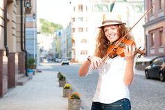 Woman play violin on the street Royalty Free Stock Image