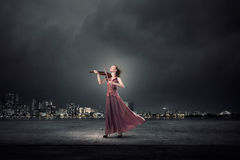 Woman play violin Royalty Free Stock Images