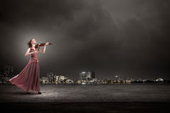 Woman play violin Stock Photos