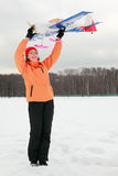 Woman played with airplane at winter Stock Photography